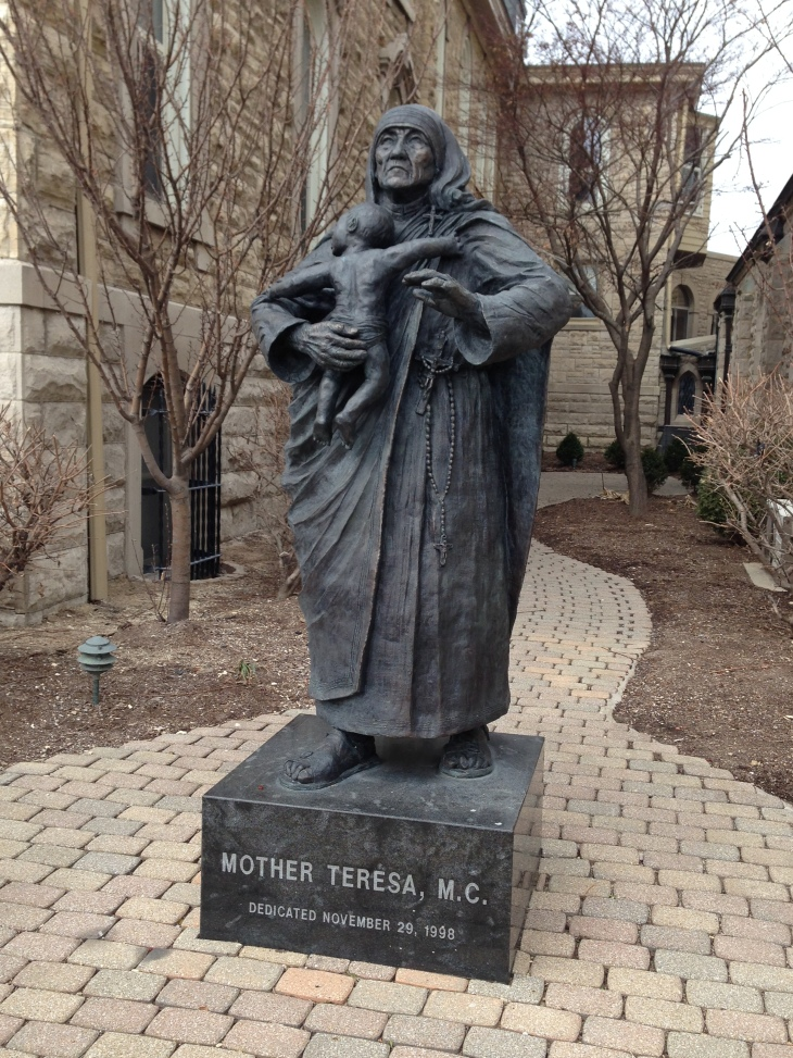 statue of Mother Teresa in the church yard