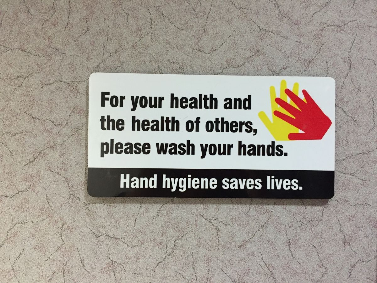 "Hand hygiene saves lives. a sign reading ""please wash your hands"""