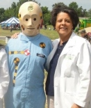 a female doctor with a Crash Dummy