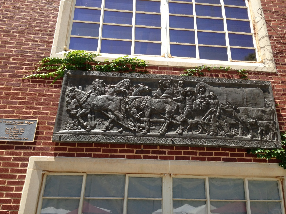 LARGE PLAQUE ON A BRICK BUILDING