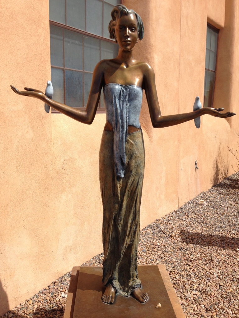 statue of a young woman with outstretched arms