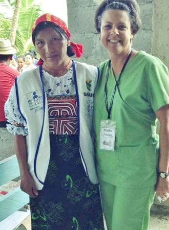 two health care professionals, one in a native costume