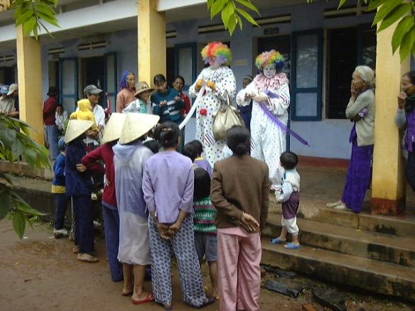 clowns entertain Vietnamese people