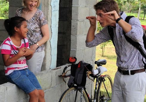 a man making faces at a little girl