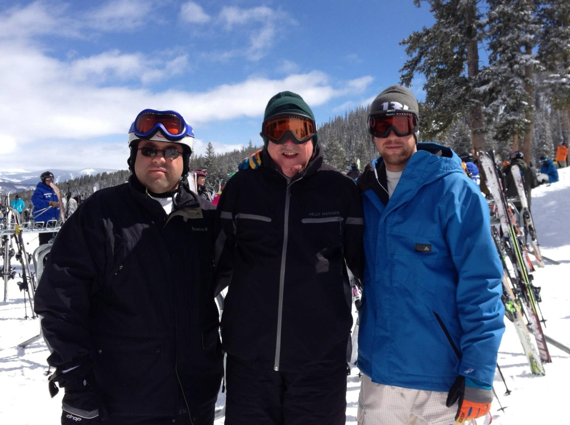 3 men in ski gear on a mountain