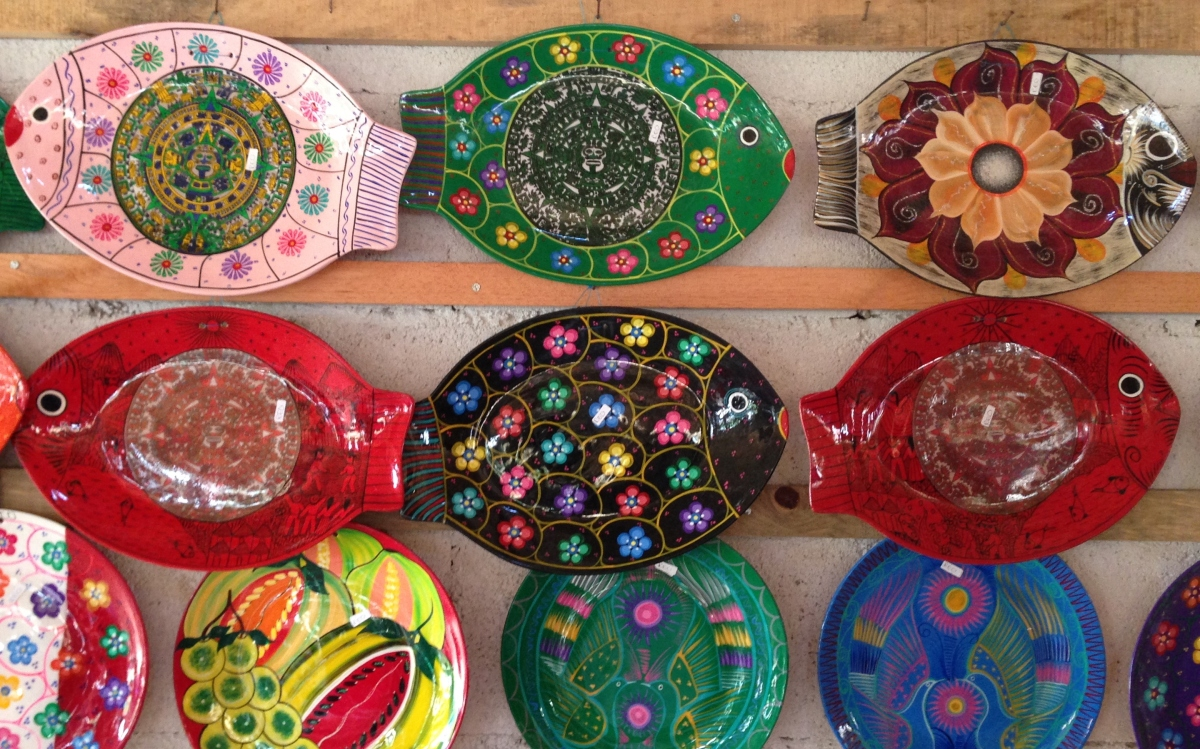 bright color plates hanging on display in a shop