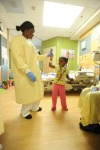 a nurse with a child in a hospital