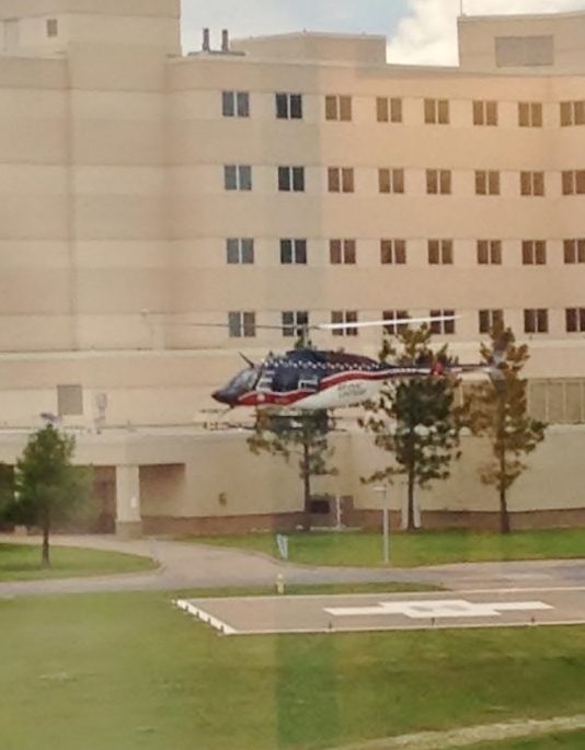 Helicopter landing at a hospital to deliver a critically ill person.