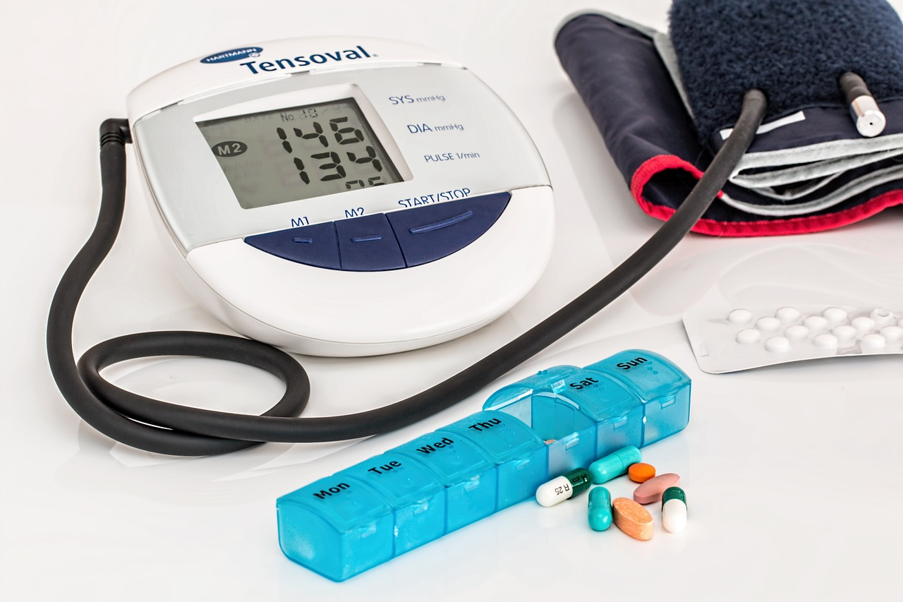 blood pressure cuff, pill holder with medication
