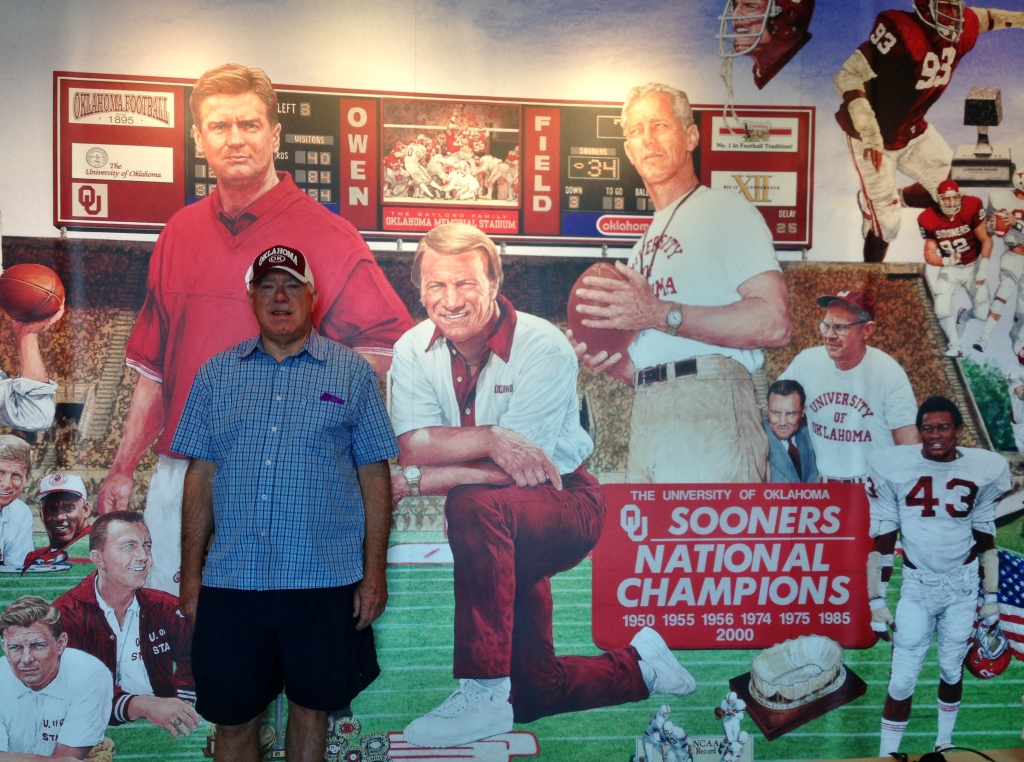 life size mural depicting the past and current coaches of the OU Sooners (my husband modelling for me)