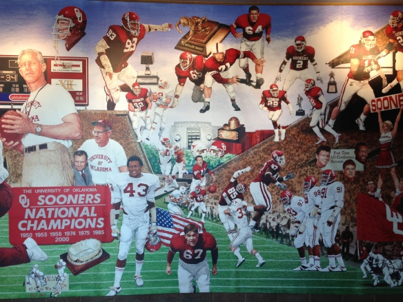 a mural with football team of the University of Oklahoma