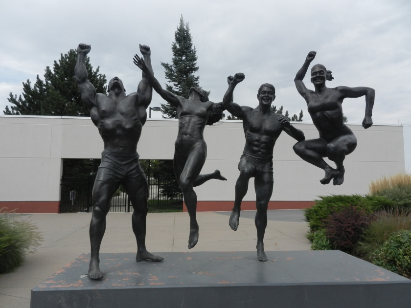 statue of athletes at entrance to facility