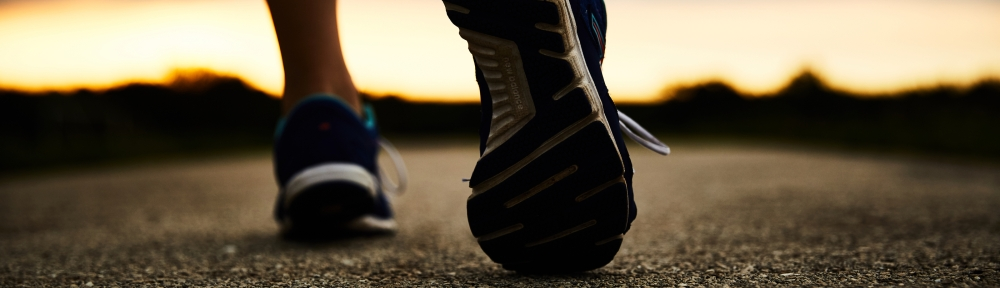 close up of walking down a road in sports shoes
