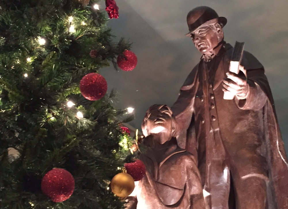 Christmas tree, statues of old man and a boy