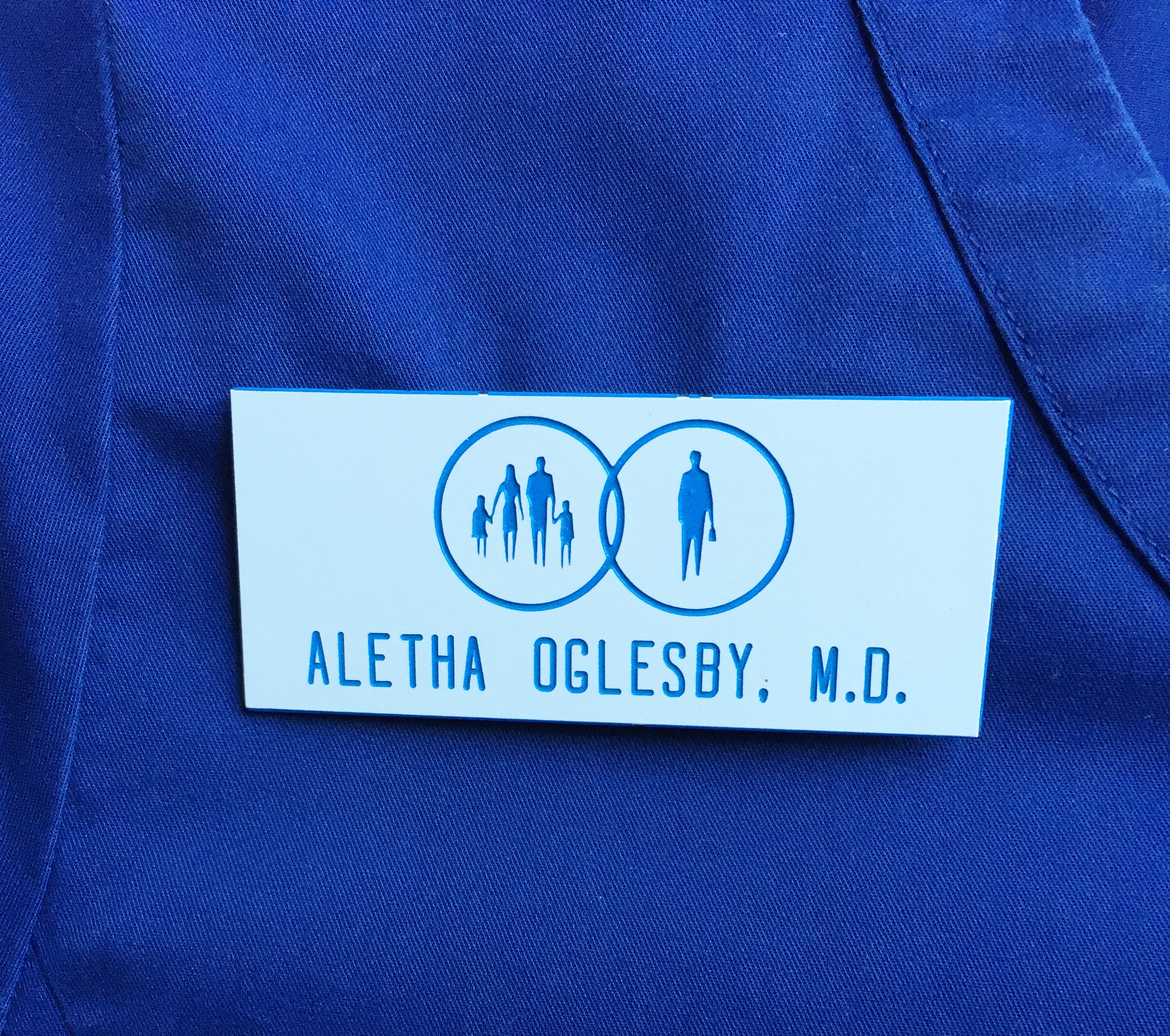 a nametag reading ALETHA OGLESBY, M.D.