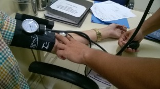 taking blood pressure
