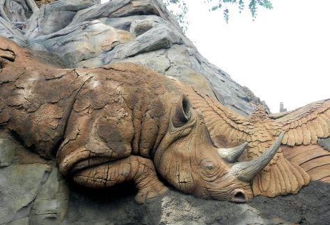 a rhinoceros carved into a rock