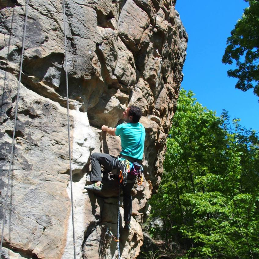 Man climbing up a rock wall