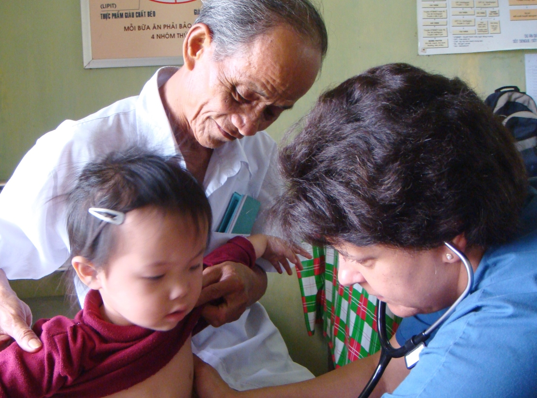 Dr. Aletha treating a child