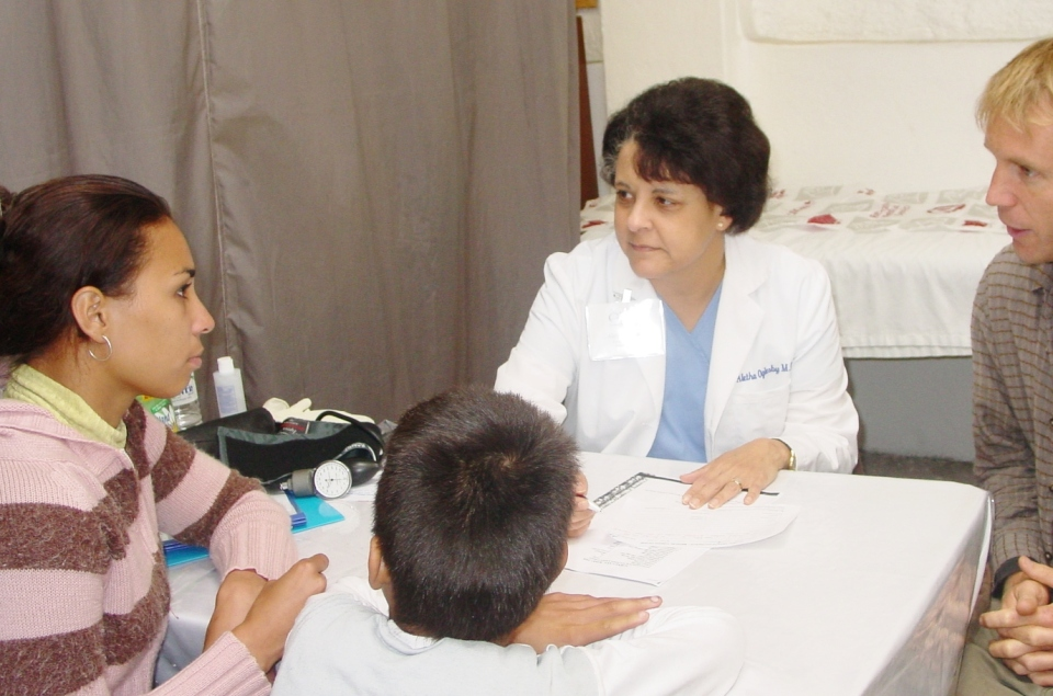 Dr. Aletha talking to a mother and her son