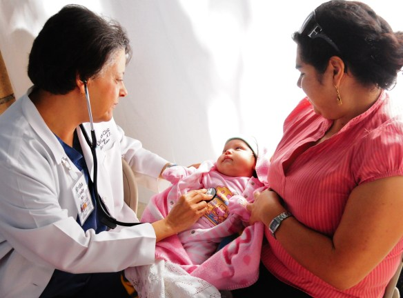 Dr. Aletha examining an infant