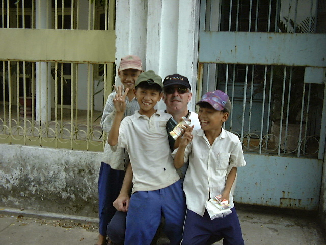 man with Vietnamese boys laughing