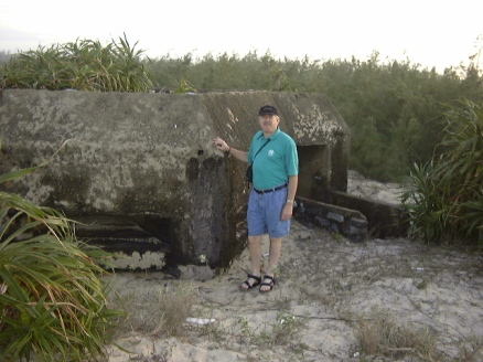 man next to concrete bunker