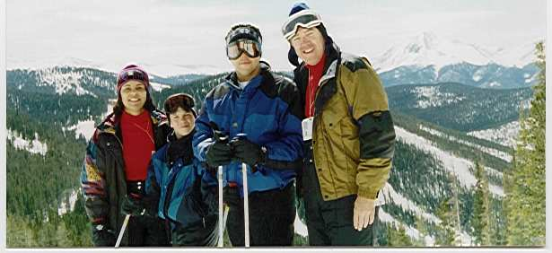 family skiing on mountain