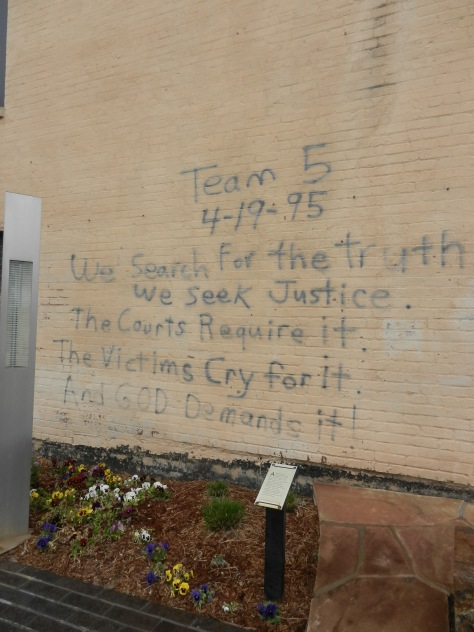 """""""We search for the Truth"""" written on a wall."""