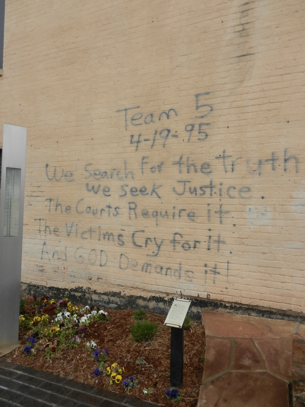"""We search for the Truth"" written on a wall."