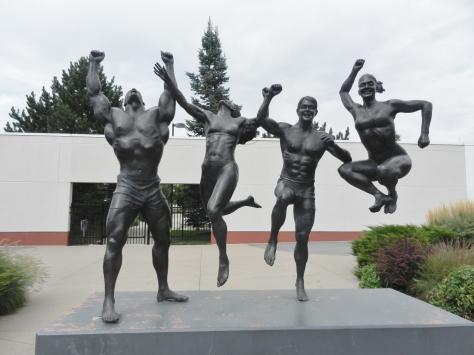 statues of athletes jumping