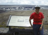 woman at a volcano crater in Hawaii