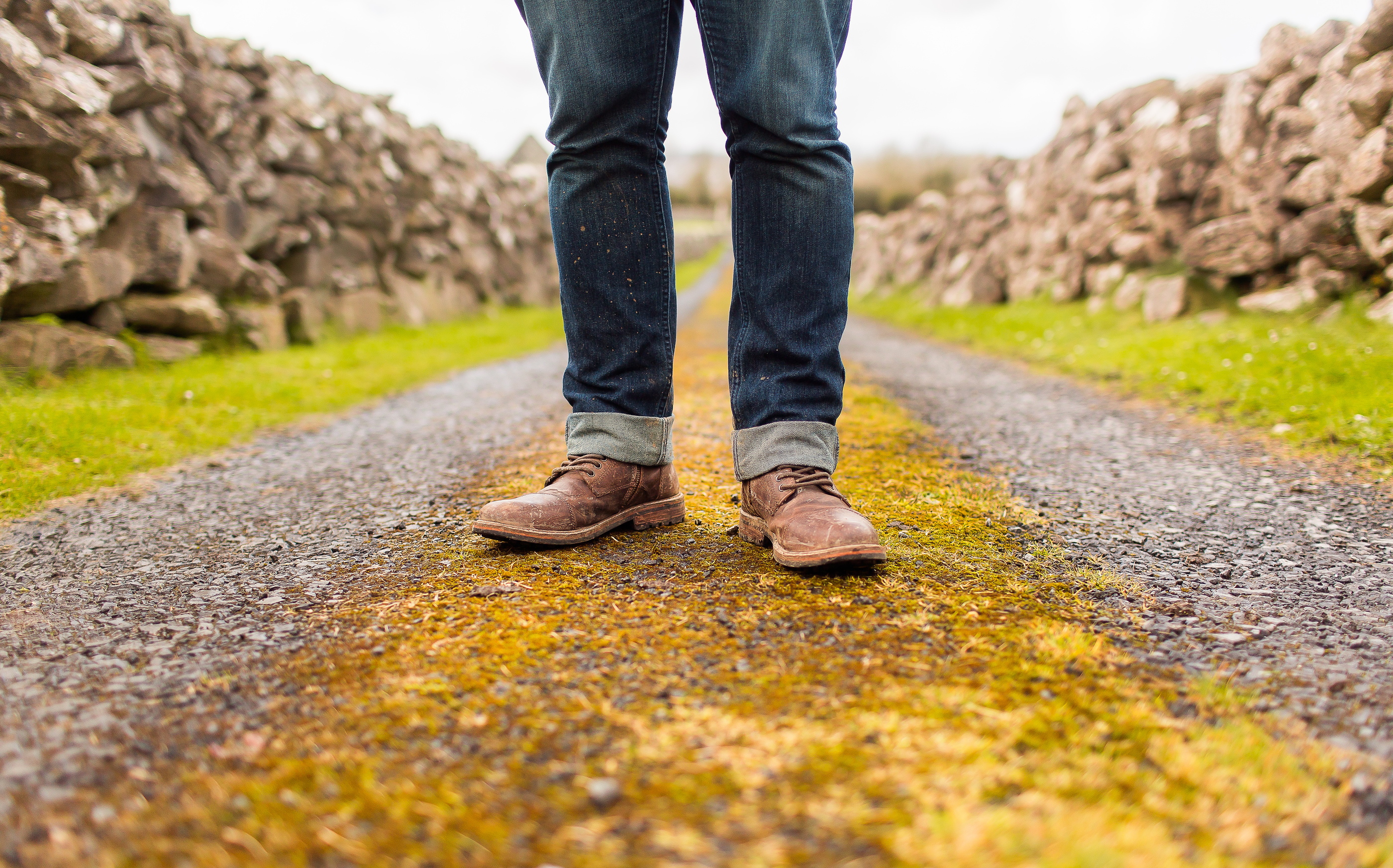 man in jeans standing in a path