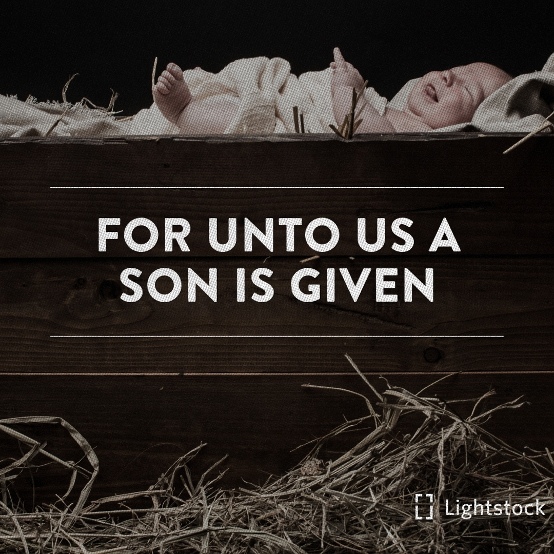"""For unto us a son is given"" baby lying in a manger"