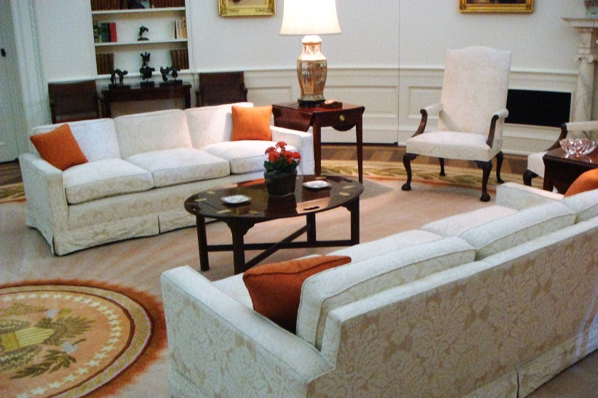 couches in room with Presidential seal on the floor
