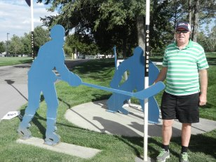 man standing next to hockey players
