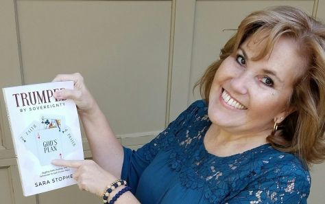 Sara Stophel with her book, Trumped By Sovereignty