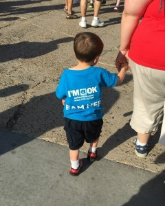 little boy walking with mother, holding hands