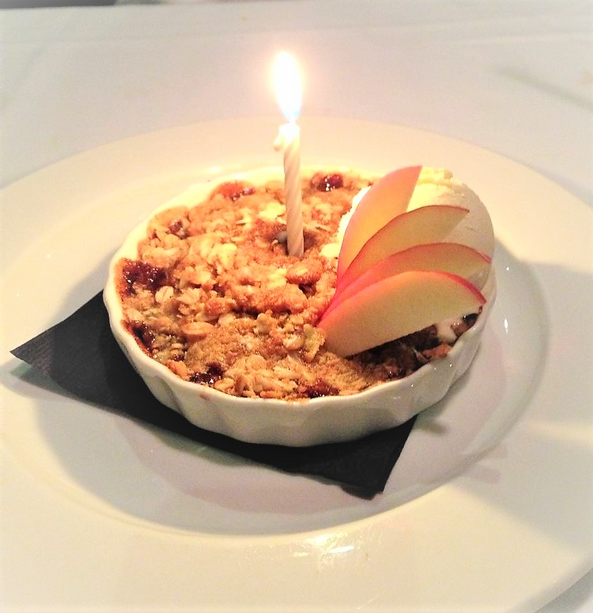 dessert with a lit candle in the middle