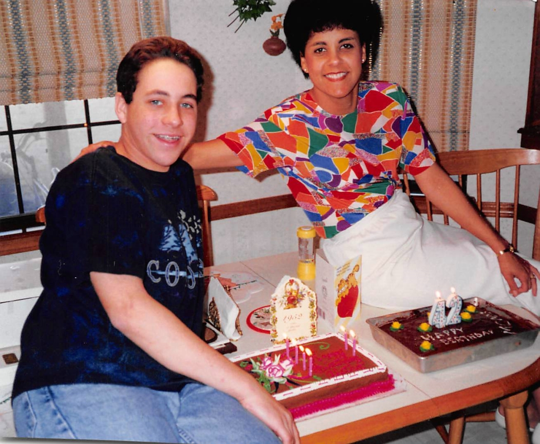 boy and woman with birthday cakes