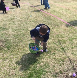 little boy with Easter basket full of eggs