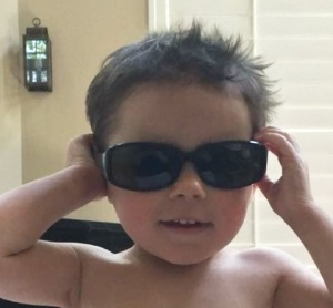 little boy wearing sunglasses