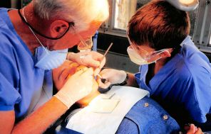 a dentist treating a patient