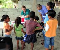 nurse with kids at a rural clinic in Panama