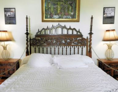 a bed with ornate headboard