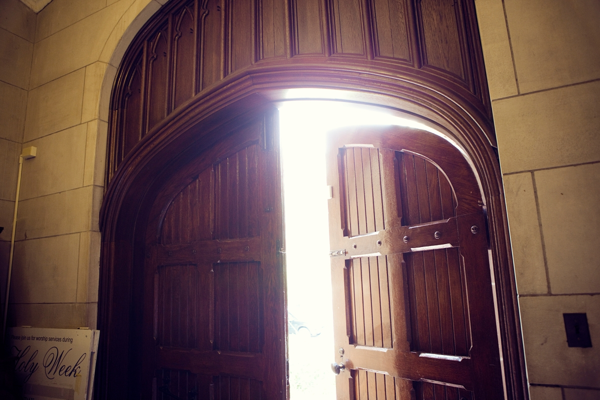 bright light shining through heavy wood doors