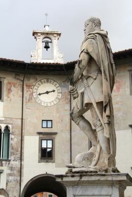 statue of an ancient soldier with an old clock