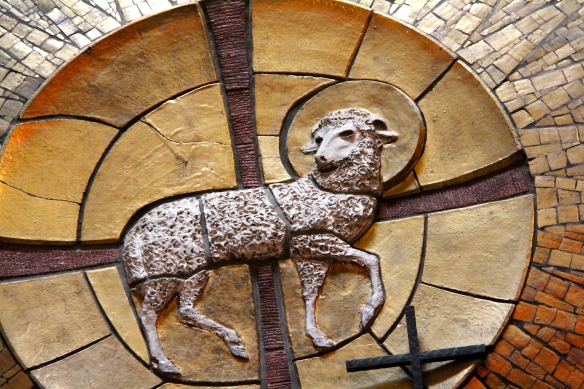 mosaic mural of a lamb and a cross