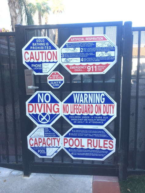 caution signs at a swimming pool.