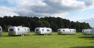Airstream travel trailers parked at a campground
